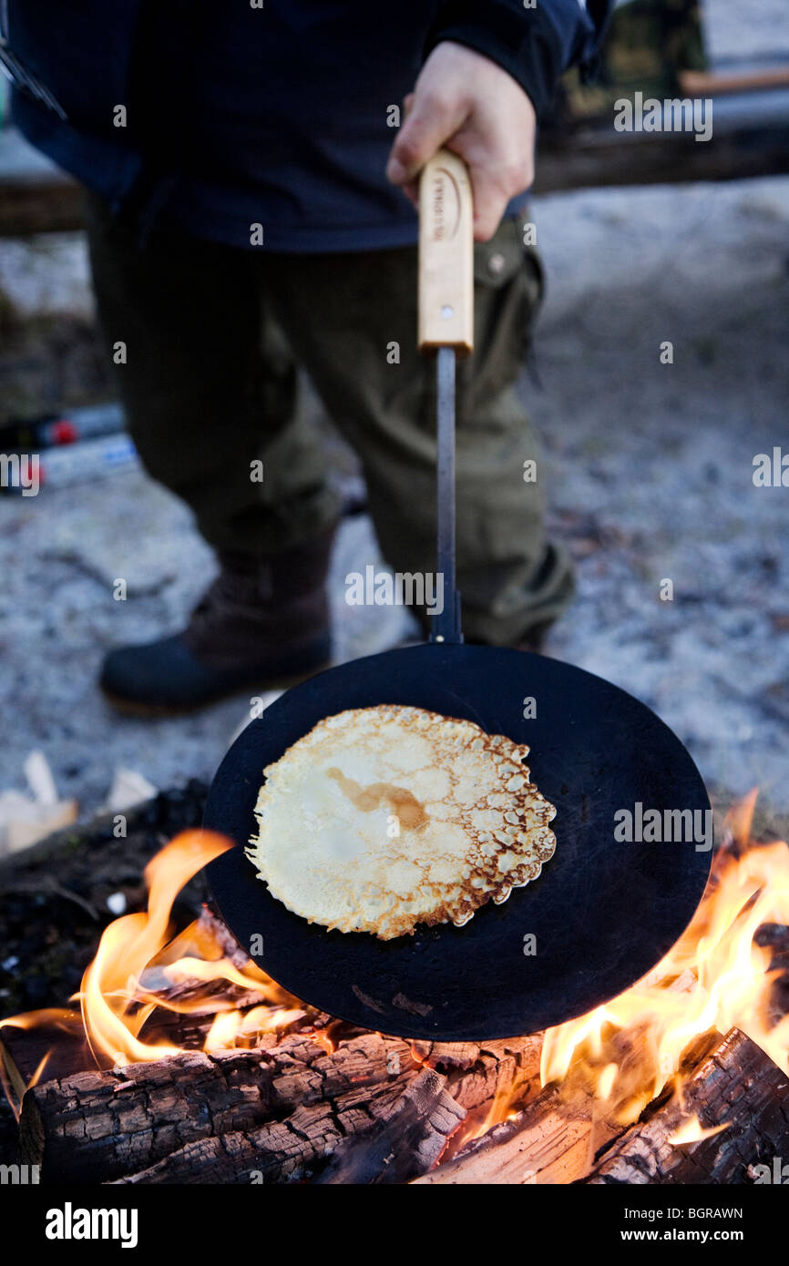 Pancakes made over open fire - Stock Image