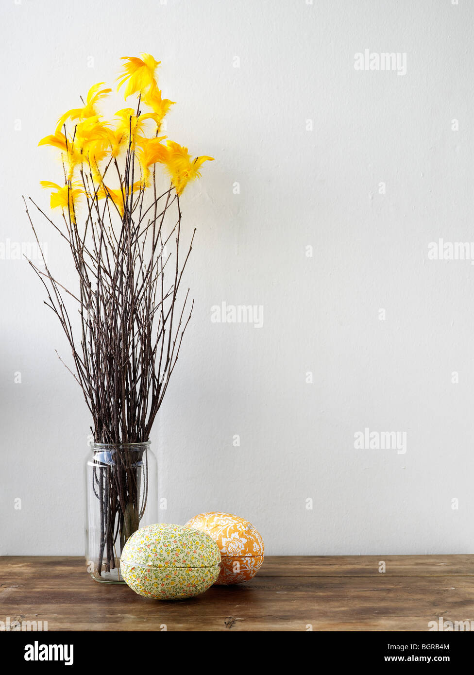 Easter eggs and twigs with feathers - Stock Image