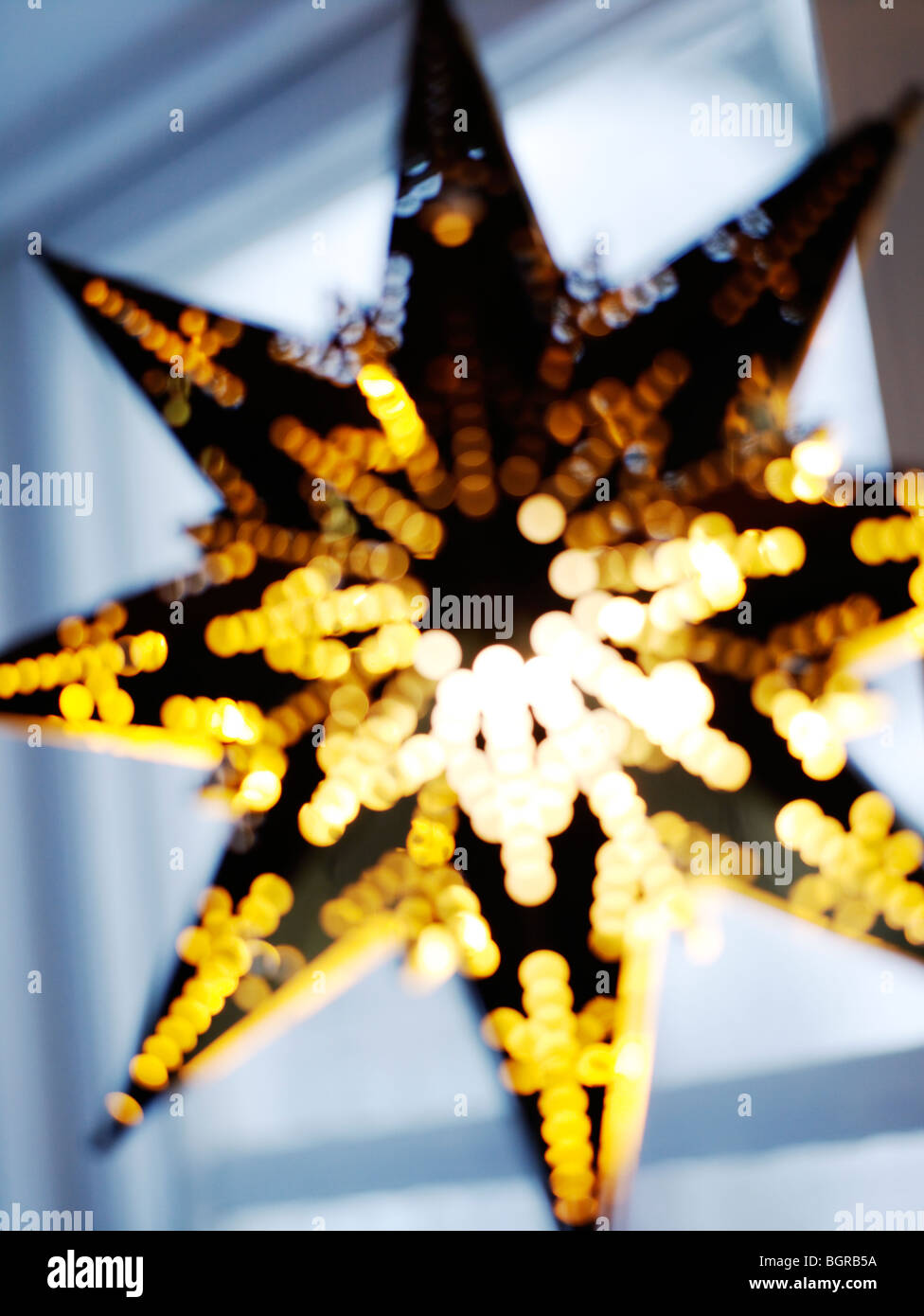 A star-shaped lantern hung in windows during Advent and Christmas. - Stock Image