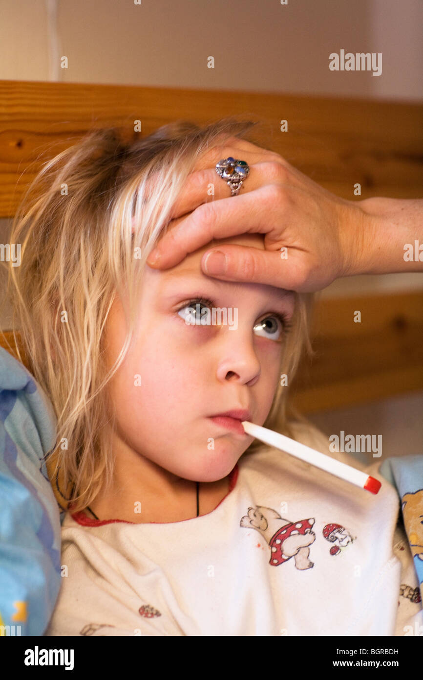 Mother taking care of sick daughter, Sweden. - Stock Image