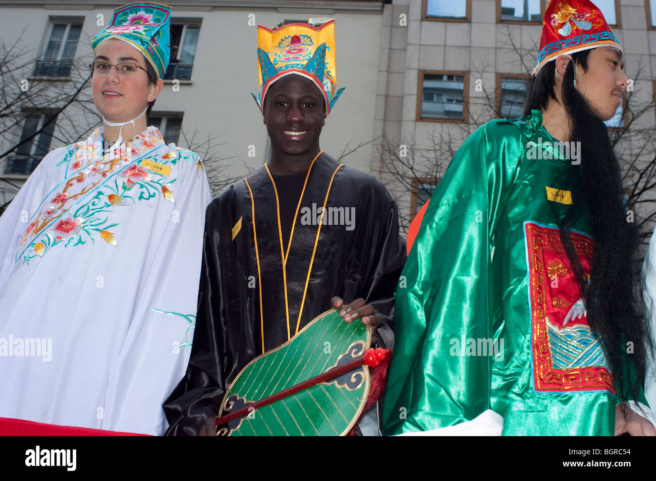 """Paris, France, group of diverse teenagers, Teens in Traditional Costumes Parading in """"Chinese new year"""" Carnival Stock Photo"""
