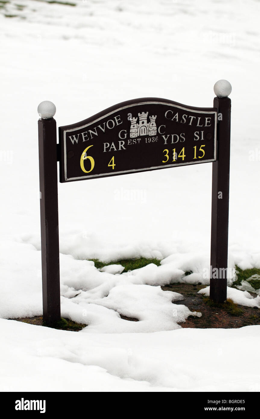 Hole 6 and a par 5 marker post in snow on the Wenvoe Castle Golf Course South Wales UK - Stock Image
