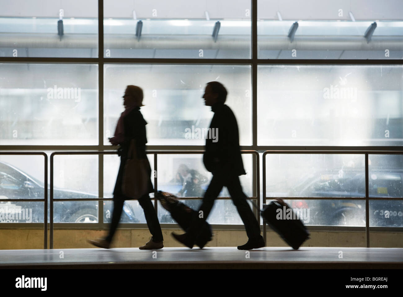 Two persons with luggage, Stockholm, Sweden. - Stock Image