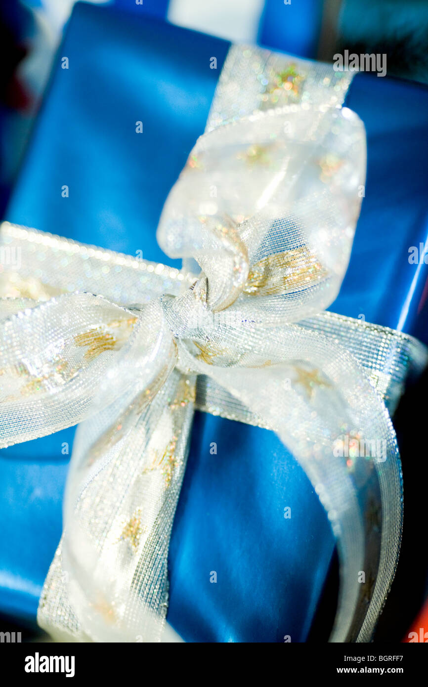 Luxurious gift with a bow, close-up. - Stock Image