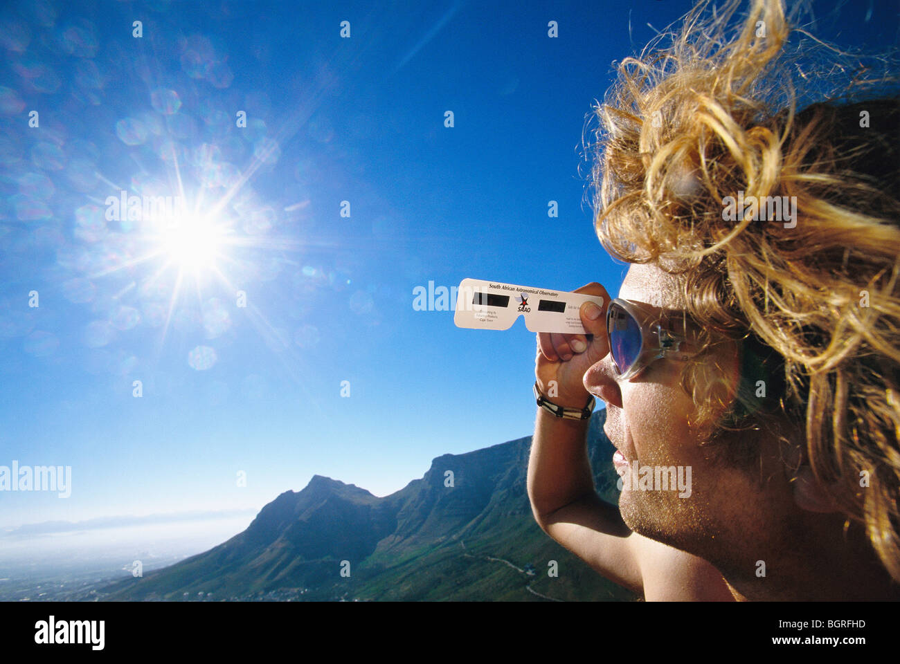 Man looking at a solar eclipse, South Africa. - Stock Image