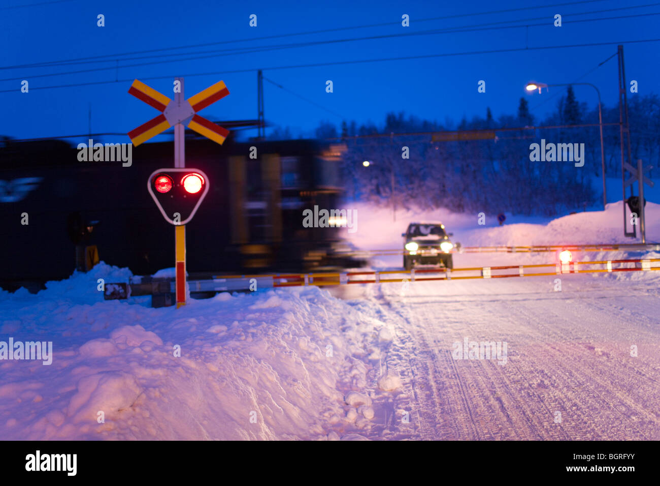 A train in motion at dusk, Sweden. - Stock Image