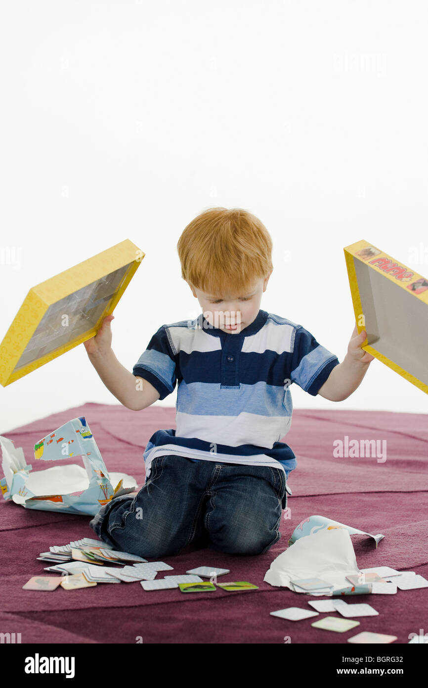 Little boy with a gift. - Stock Image