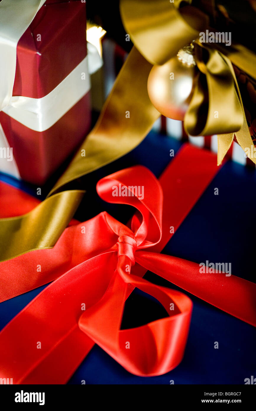 Luxurious gifts with bows, close-up. - Stock Image