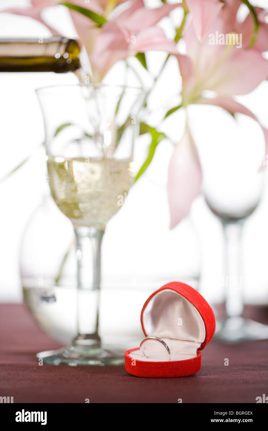 A table laid with a ring in an opened box. - Stock Image