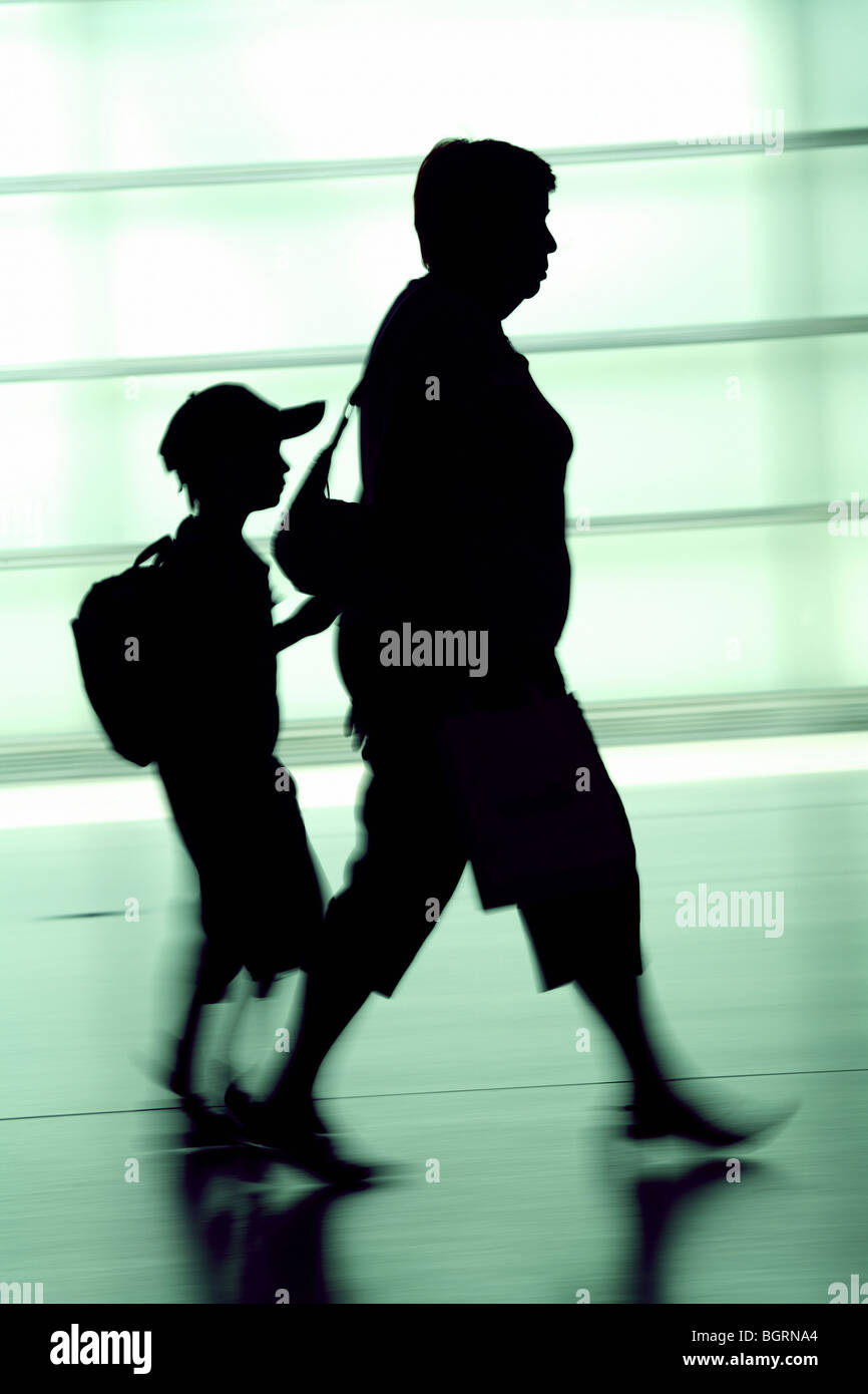 Silhouettes of a woman and a child, Berlin, Germany - Stock Image