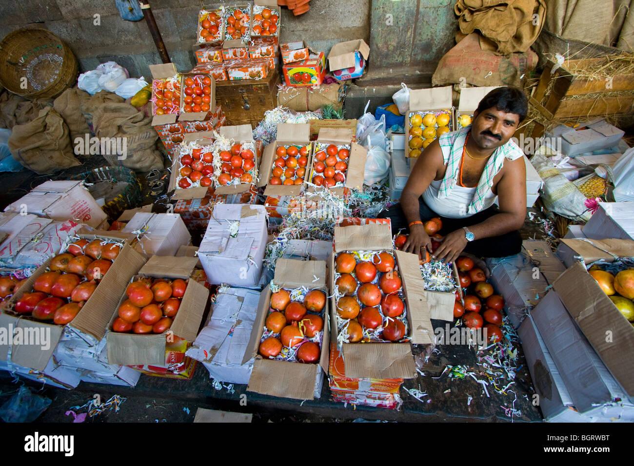 Pomegranate Vendor at Crawford Market in Mumbai India - Stock Image