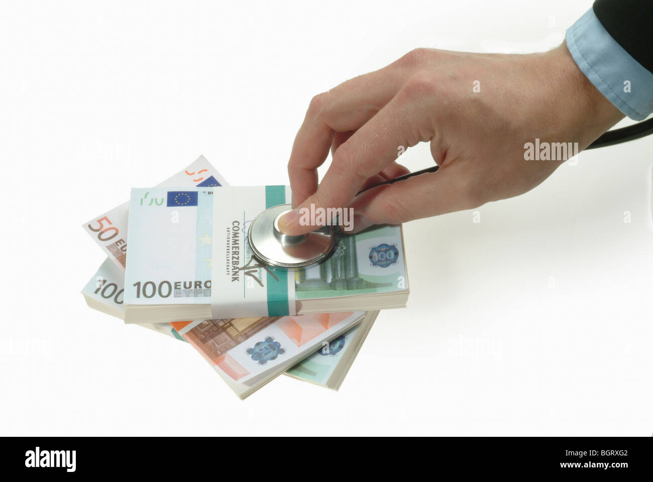 Hand with stethoscope doing a checkup on Euro banknotes Stock Photo