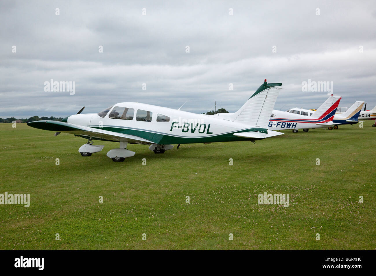 three PIPER PA-28R Cherokee light aircraft parked together - Stock Image