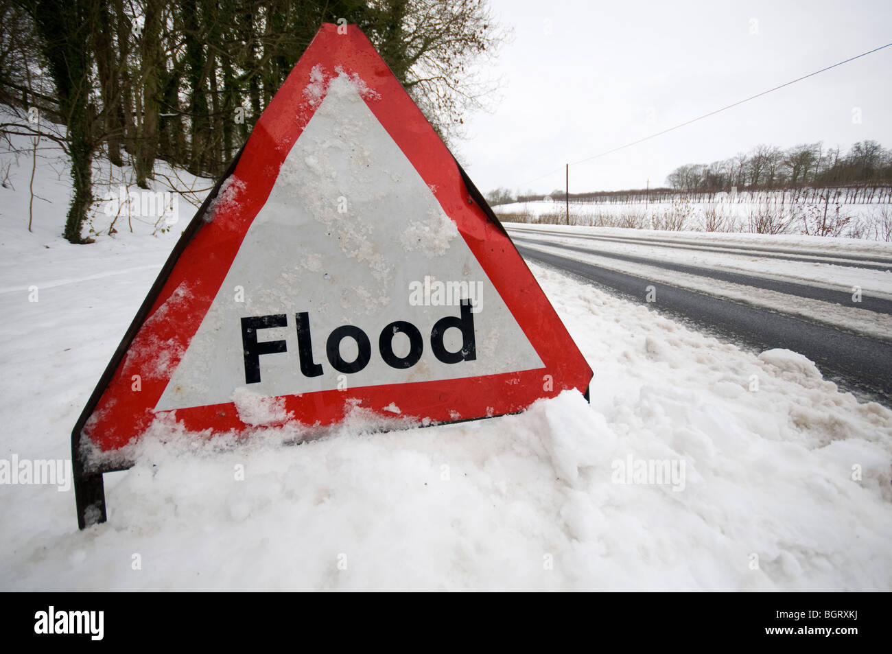Flood Sign by road in snow Kent Countryside - Stock Image