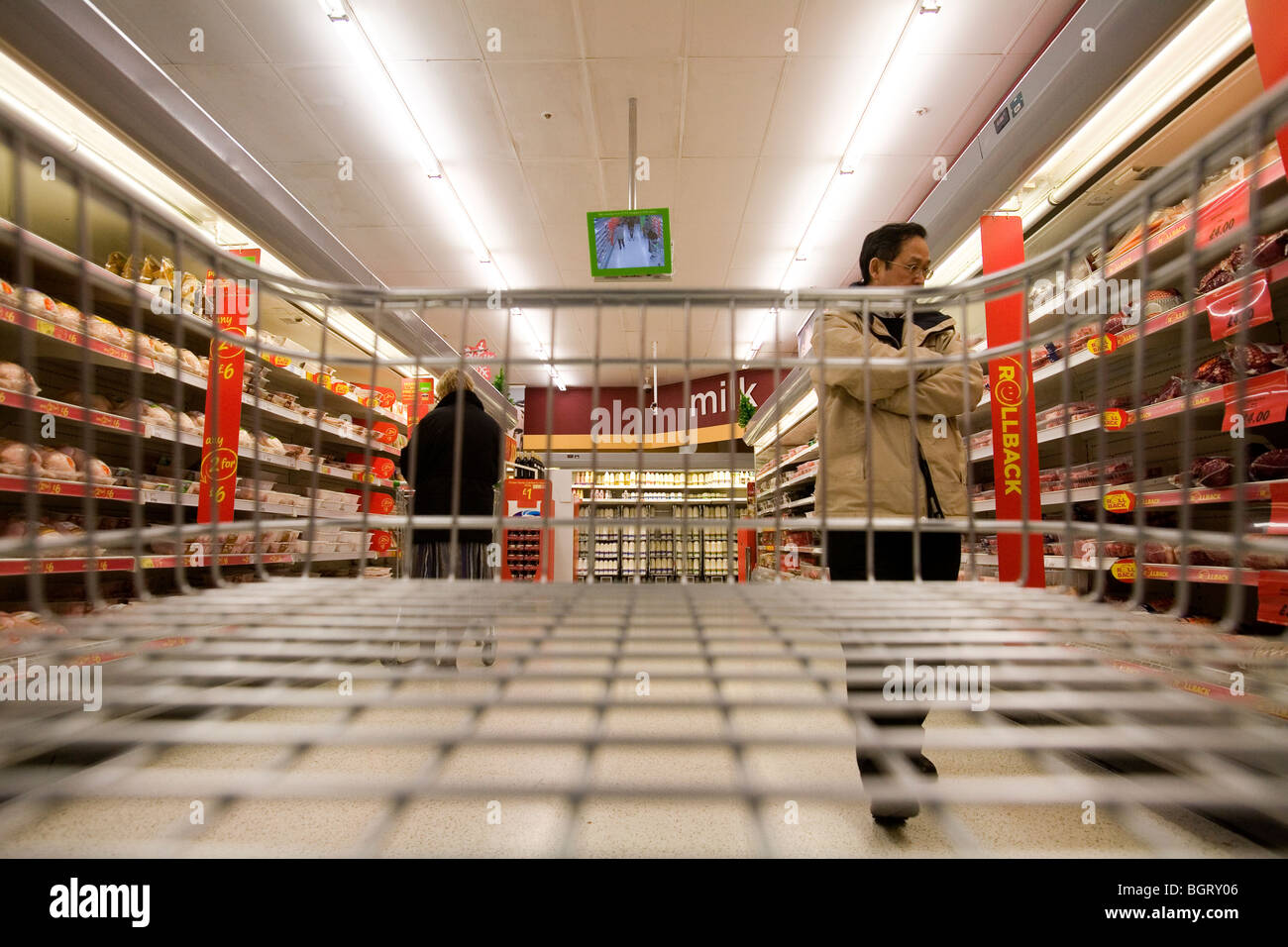 Empty trolley at supermarket  London, England, Britain, UK. - Stock Image