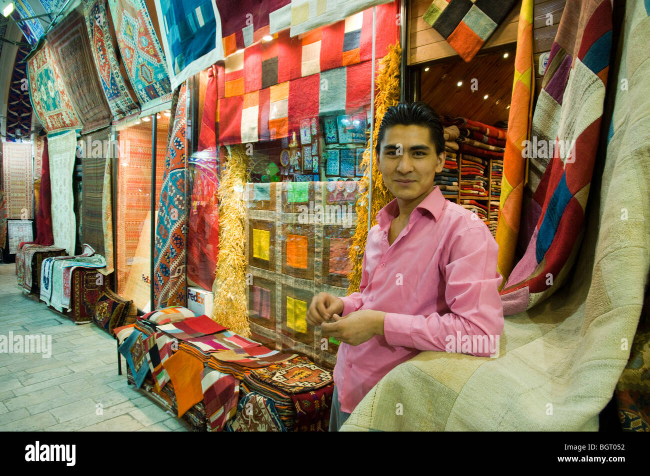 Carpets seller at the Grand Bazaar. Istanbul. Turkey. - Stock Image