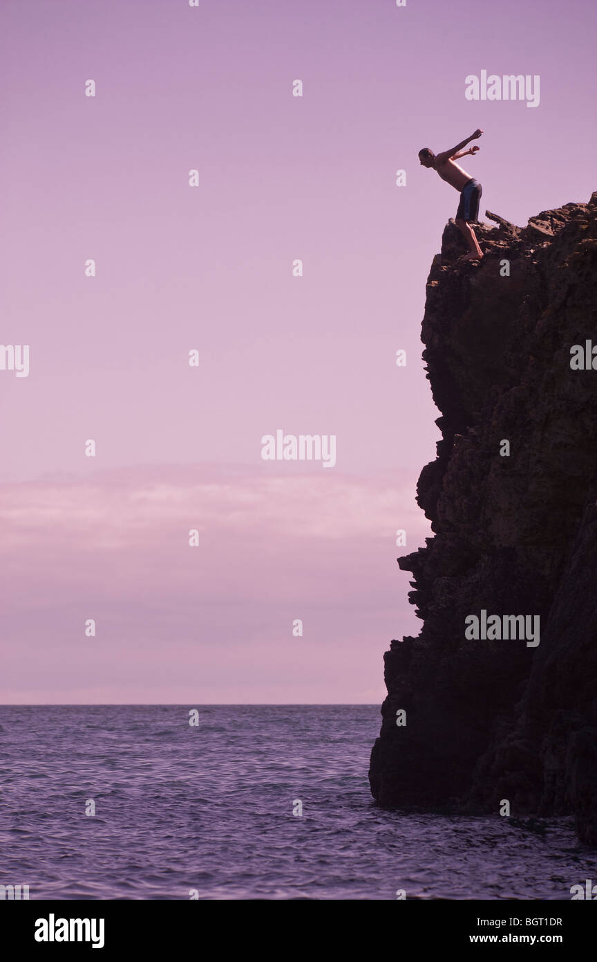 A diver at Maceley Cove, near East Prawle, Devon, England, UK. - Stock Image
