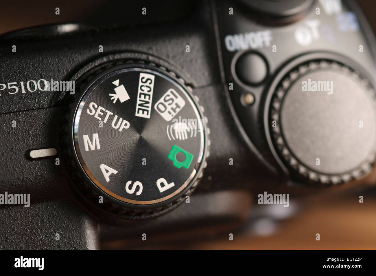 Control dial and button on digital compact camera - Stock Image