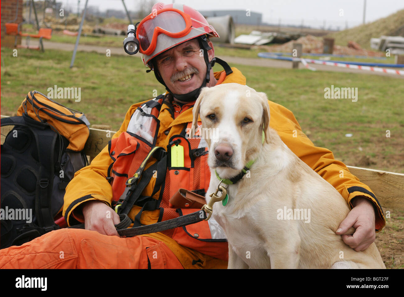 fire-fighter with Rescue dog - Stock Image