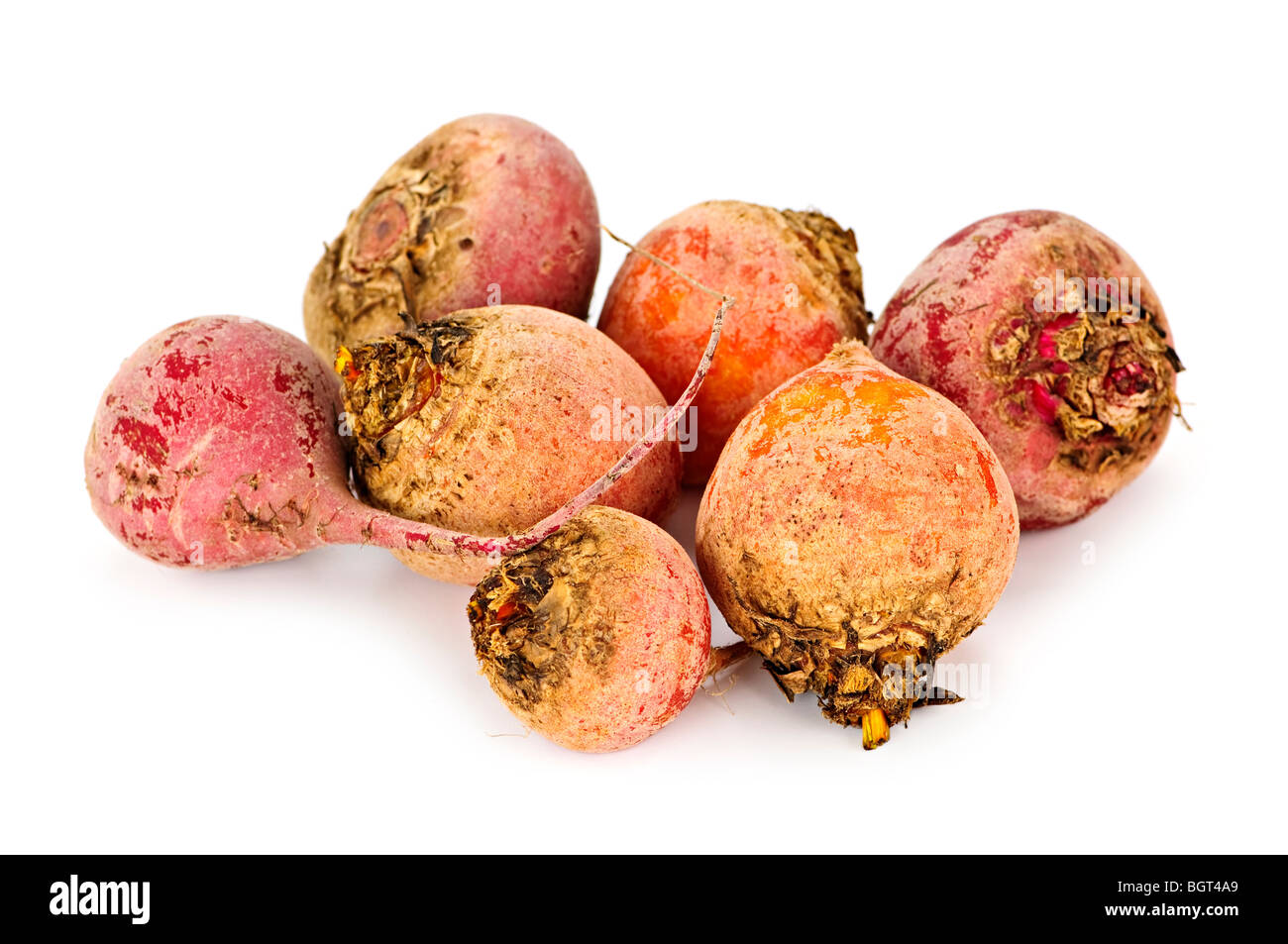 Close up of whole red and golden beets isolated on white - Stock Image
