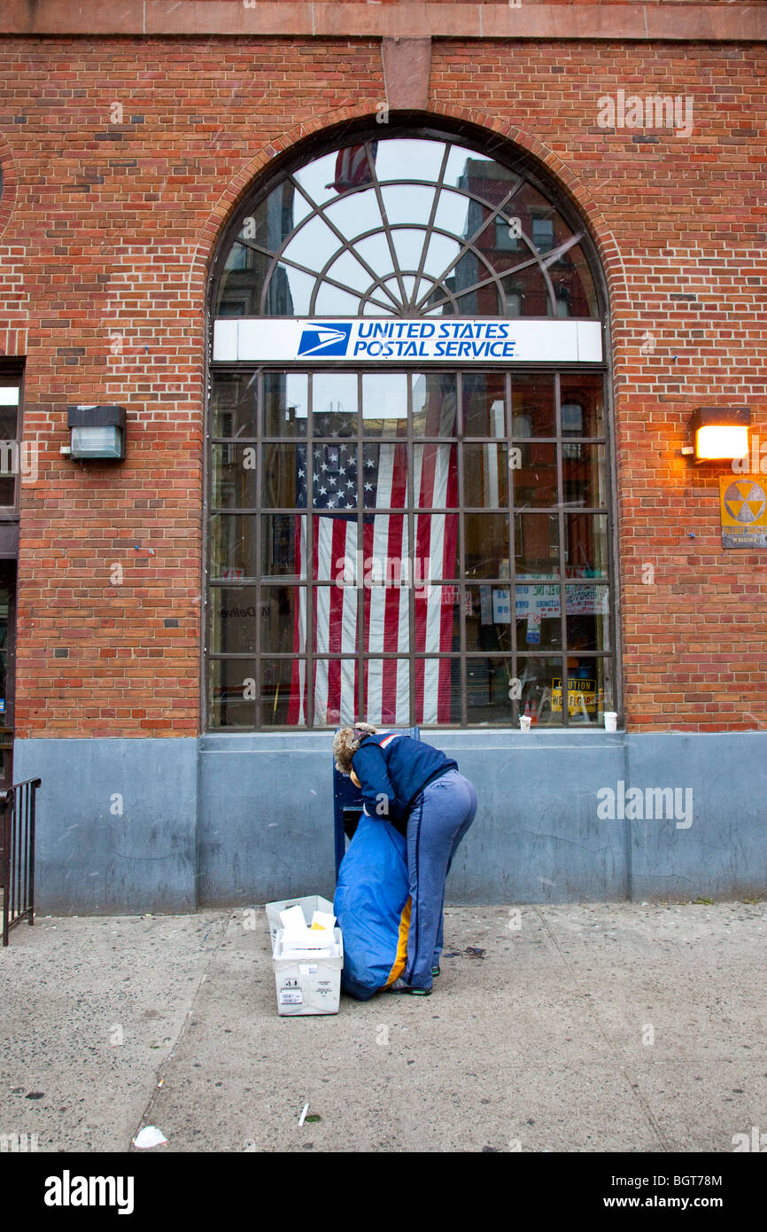 Postwoman and Post Office on the Lower East Side of Manhattan, New York City - Stock Image