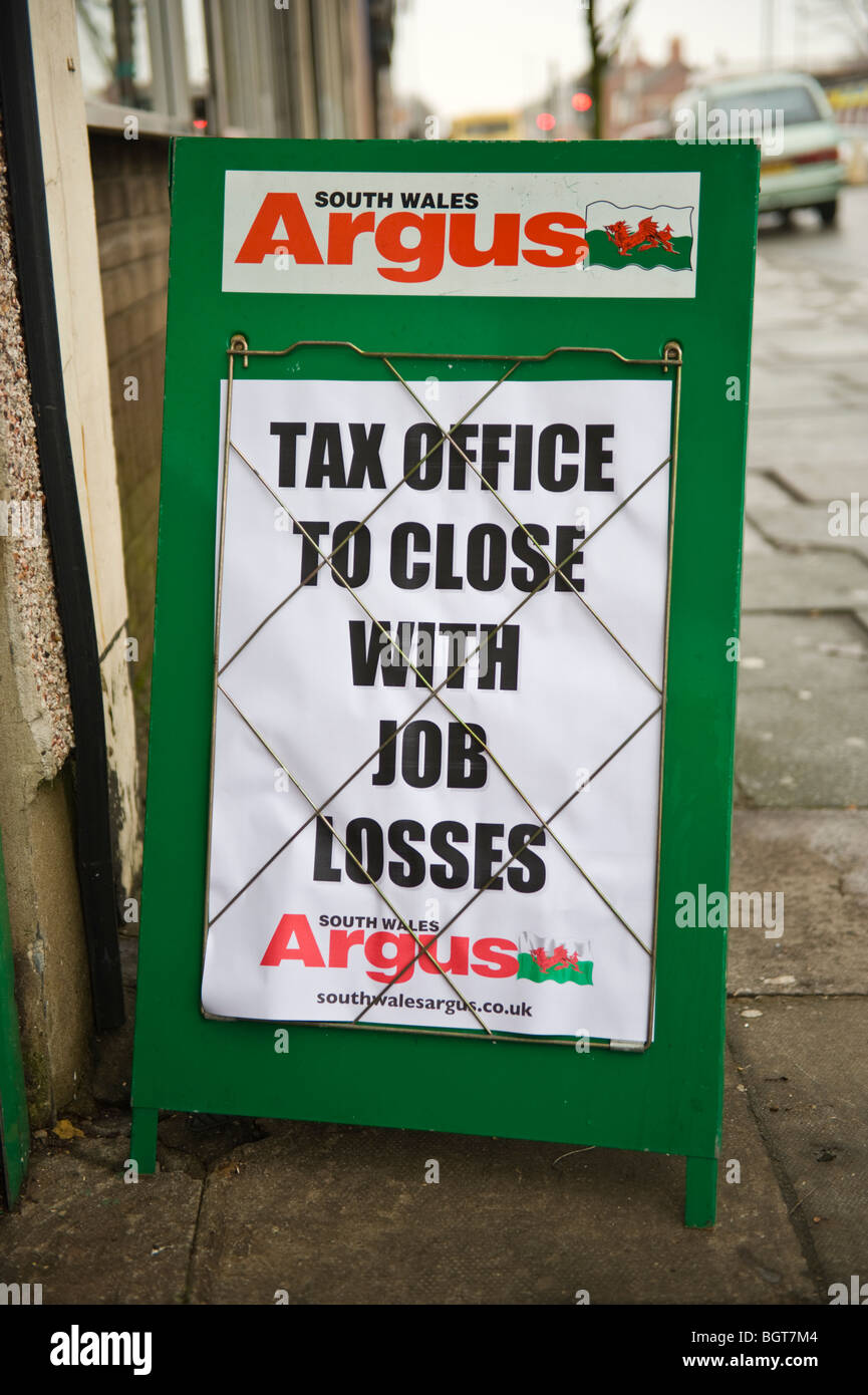 TAX OFFICE TO CLOSE WITH JOB LOSSES local newspaper headlines on street board outside newsagents in Newport South - Stock Image