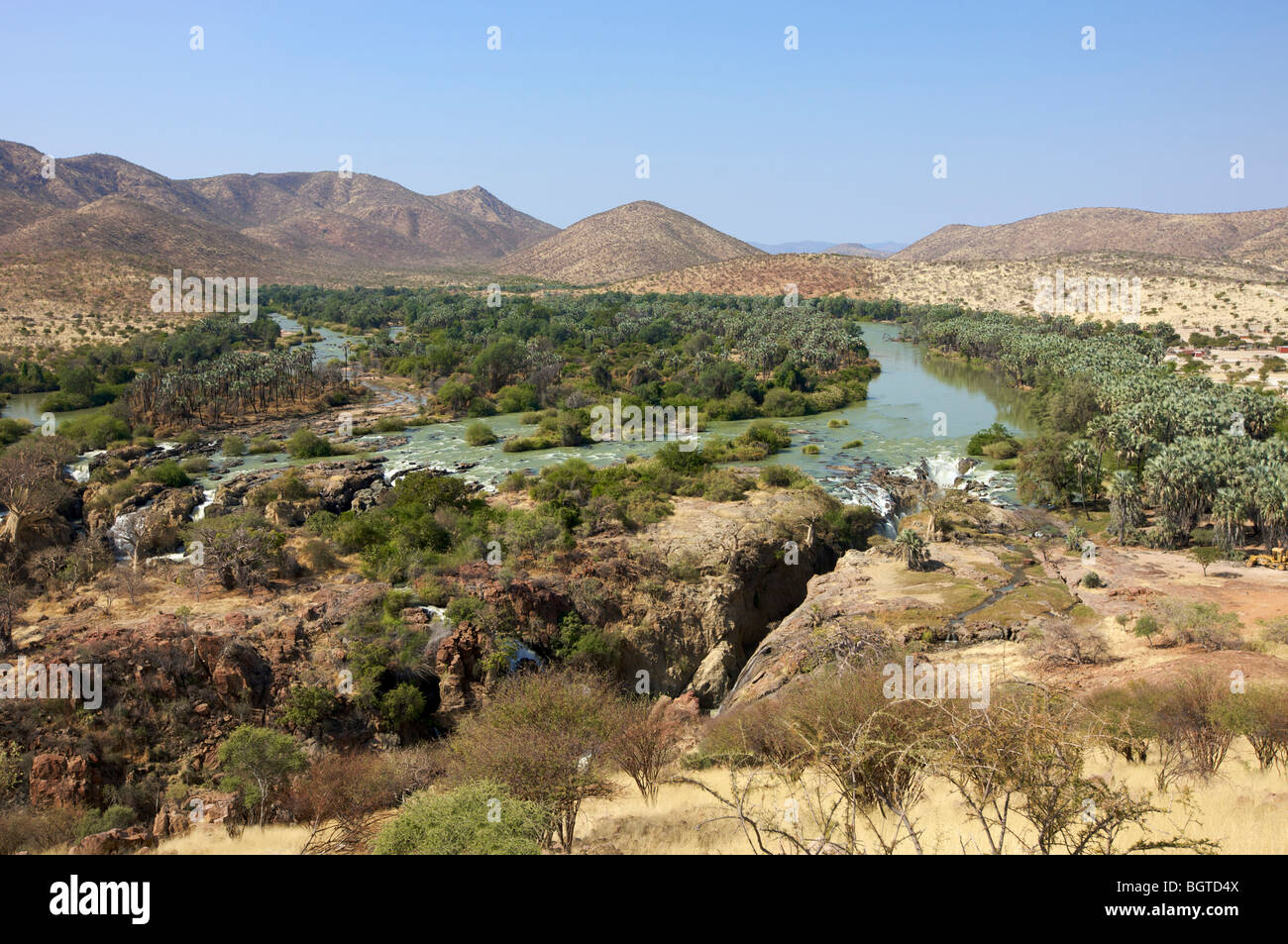 Distant view of Epupa Falls and surrounding area, Kunene River, Kaokoland, Namibia - Stock Image