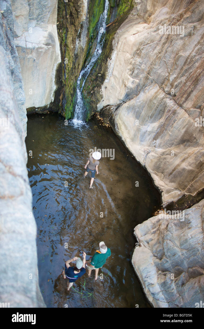 Arial view of people walking in river near waterfall, Kunene River, Kaokoland, Namibia - Stock Image