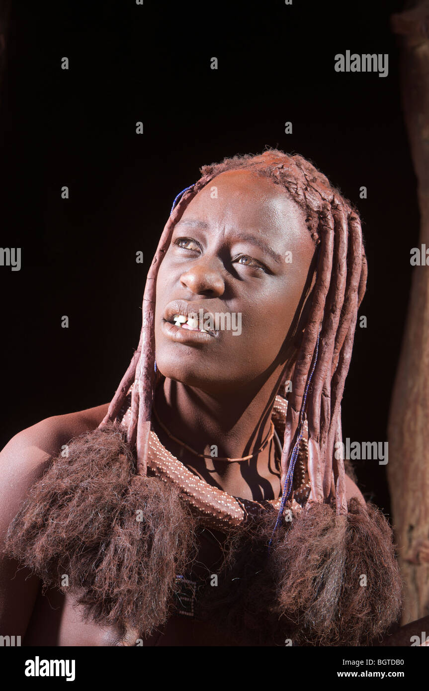 Portrait if a Himba woman showing hair adornment, Van Zyl's Pass area,Kaokoland, Namibia - Stock Image