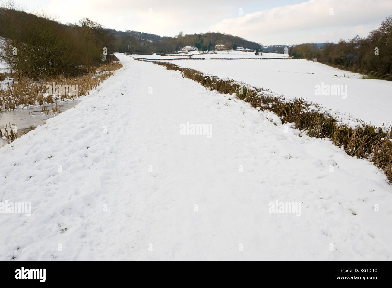Canal and towpath covered in ice and snow on the Monmouthshire and Brecon Canal at Newport South Wales UK - Stock Image