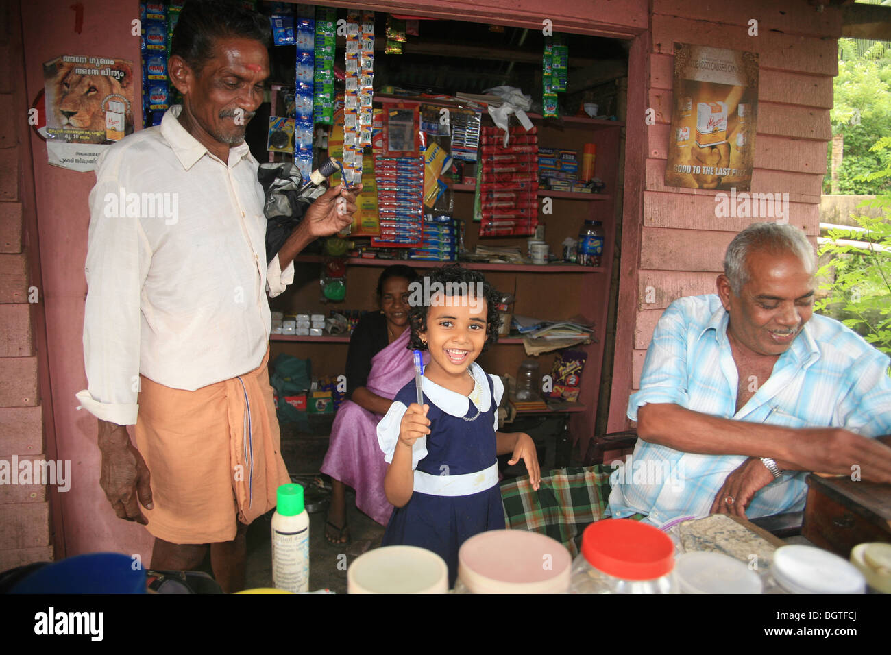 Family serving at their roadside shop, Kerala, India - Stock Image