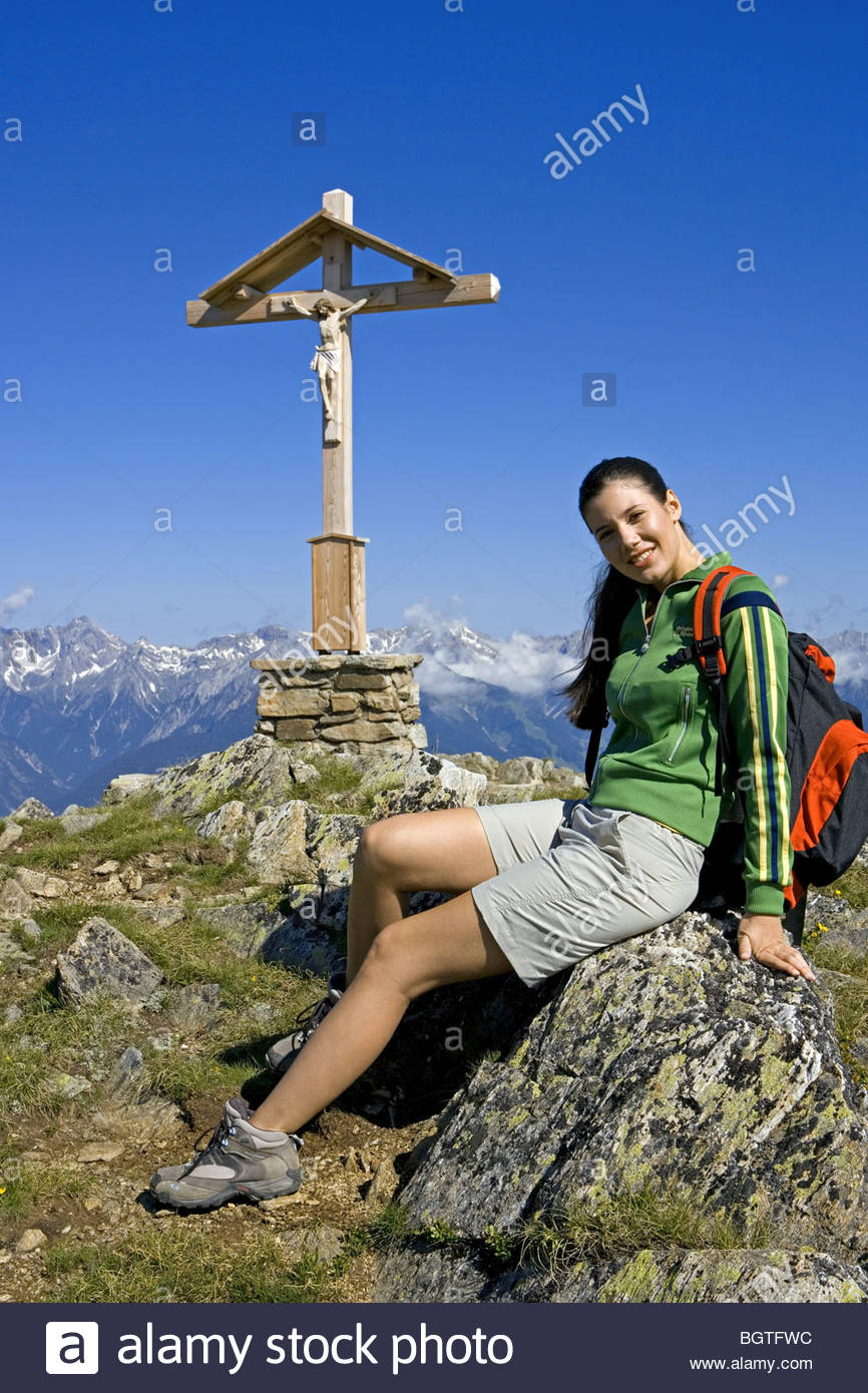 young woman hiking in moutains - Stock Image