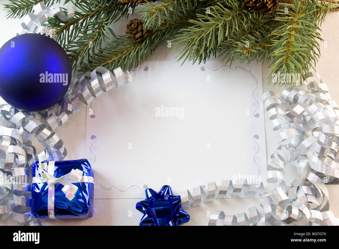 blank Christmas card with blue decorations, fir branch, and ...