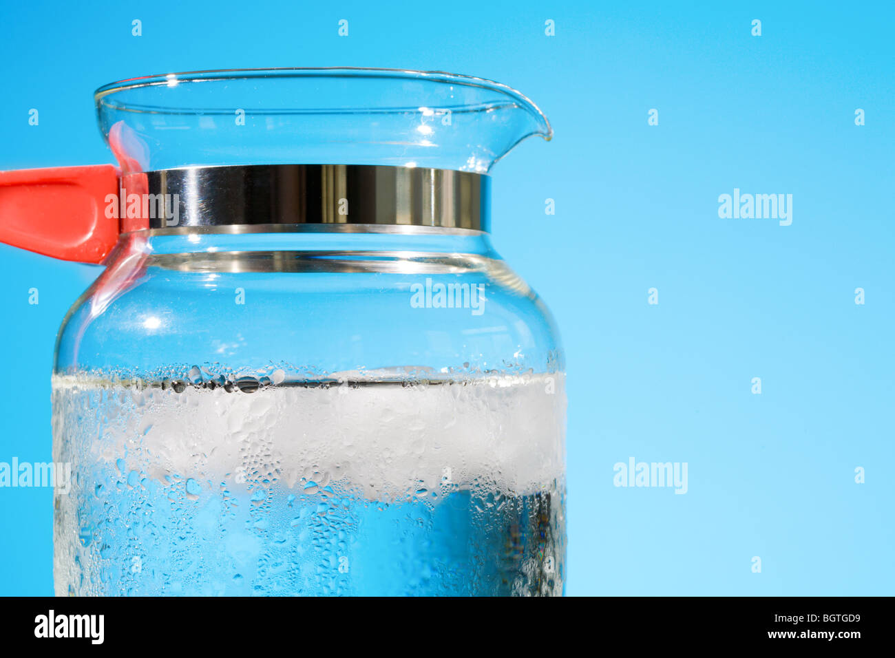 Pitcher with water and ice - Stock Image