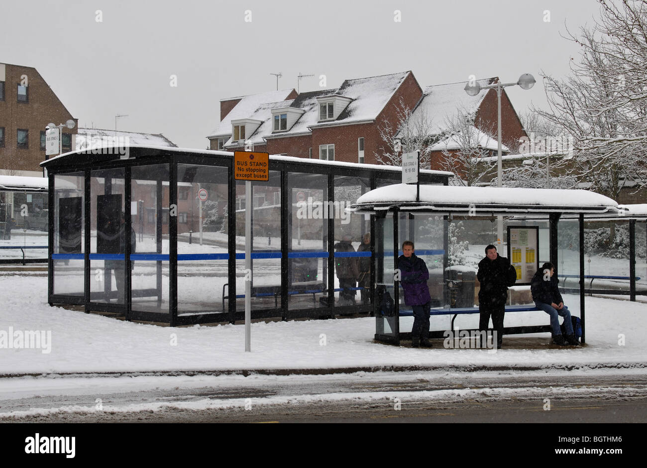 Bus shelters in snow, Warwick town centre, Warwickshire, UK - Stock Image