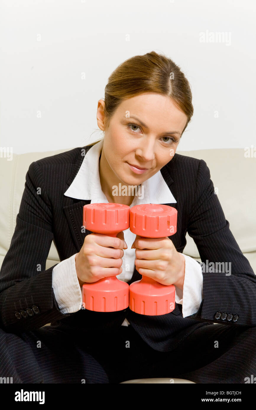 business woman with dumbbells - Stock Image
