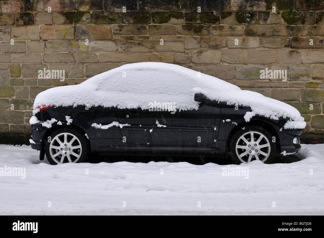 Peugeot 206CC car parked in snow, UK Stock Photo