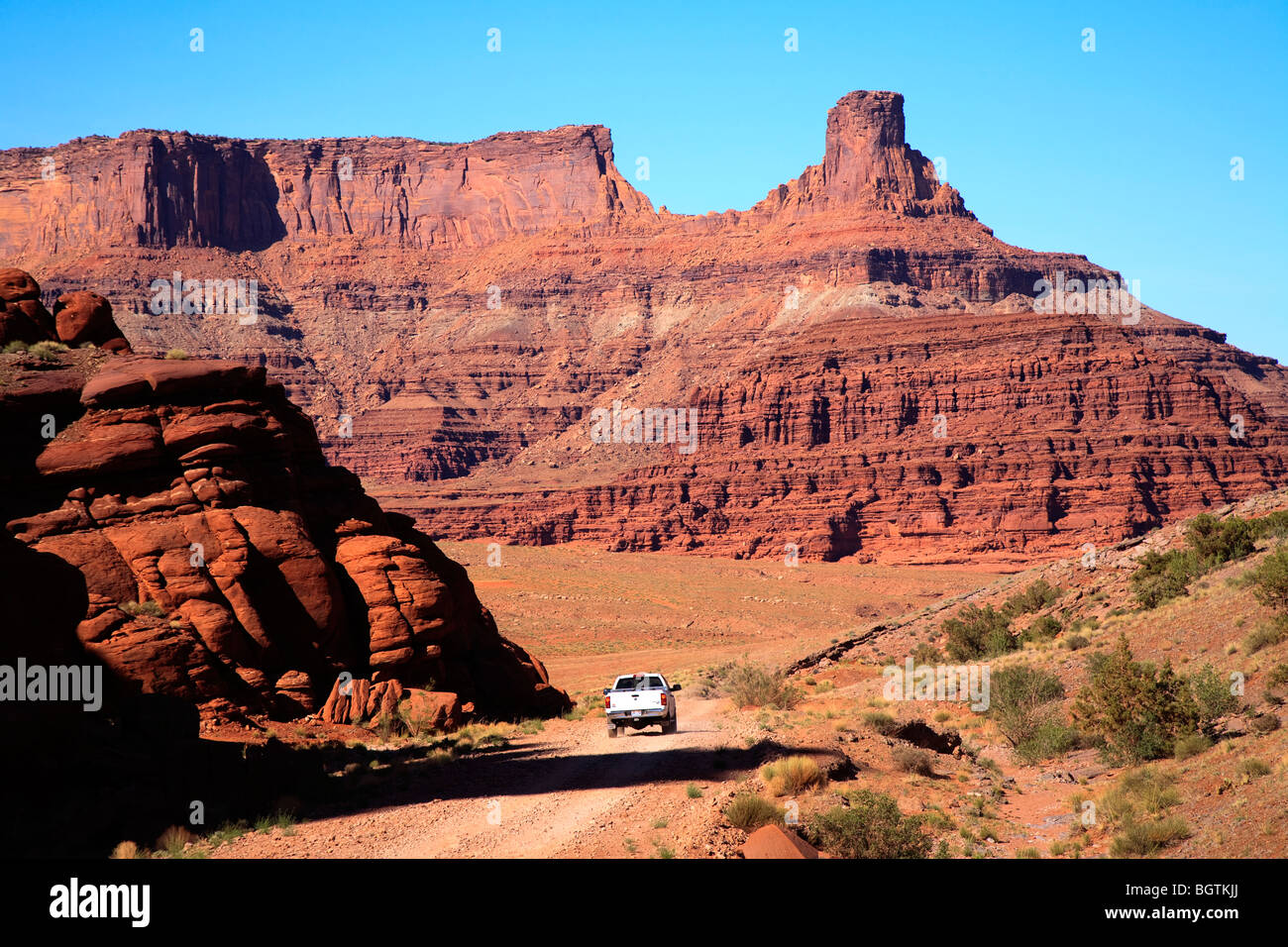 White Dodge truck on the Shafer Trail, Canyonlands National Park near Moab, Utah, USA - Stock Image