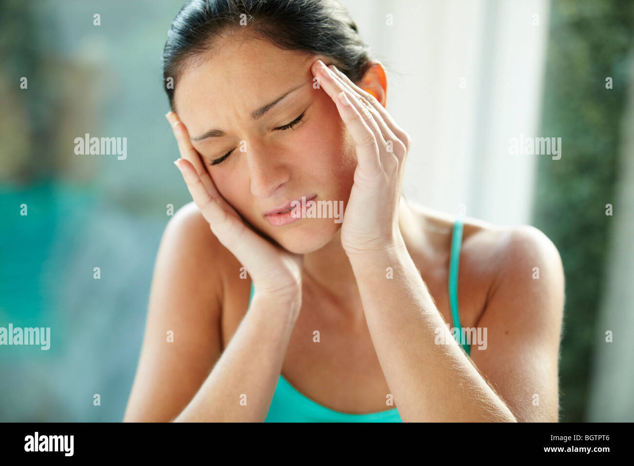 Girl with headache - Stock Image