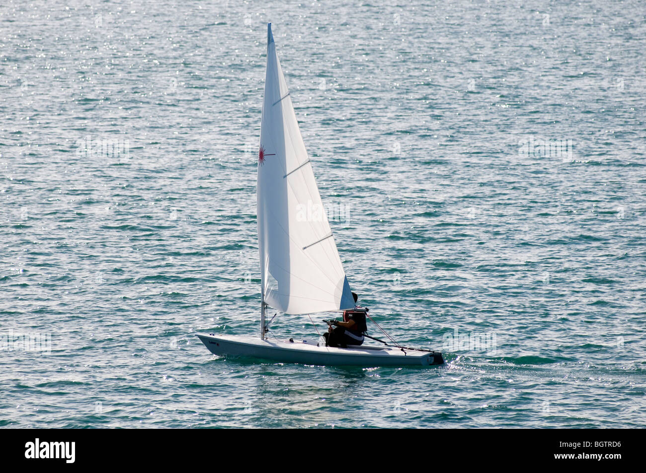 sailing boat boats yacht boating sail sailing sails wind in your sea competition one man dingy  Dingyi's - Stock Image