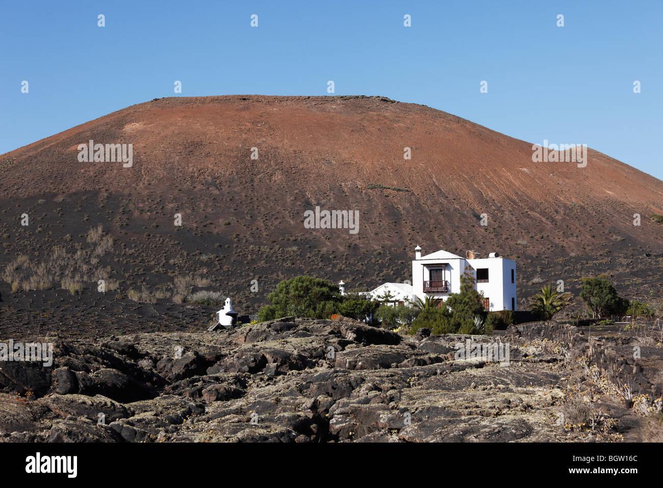 Montaña de Juan Bello volcano, house in a lava field, La Geria, Lanzarote, Canary Islands, Spain, Europe - Stock Image