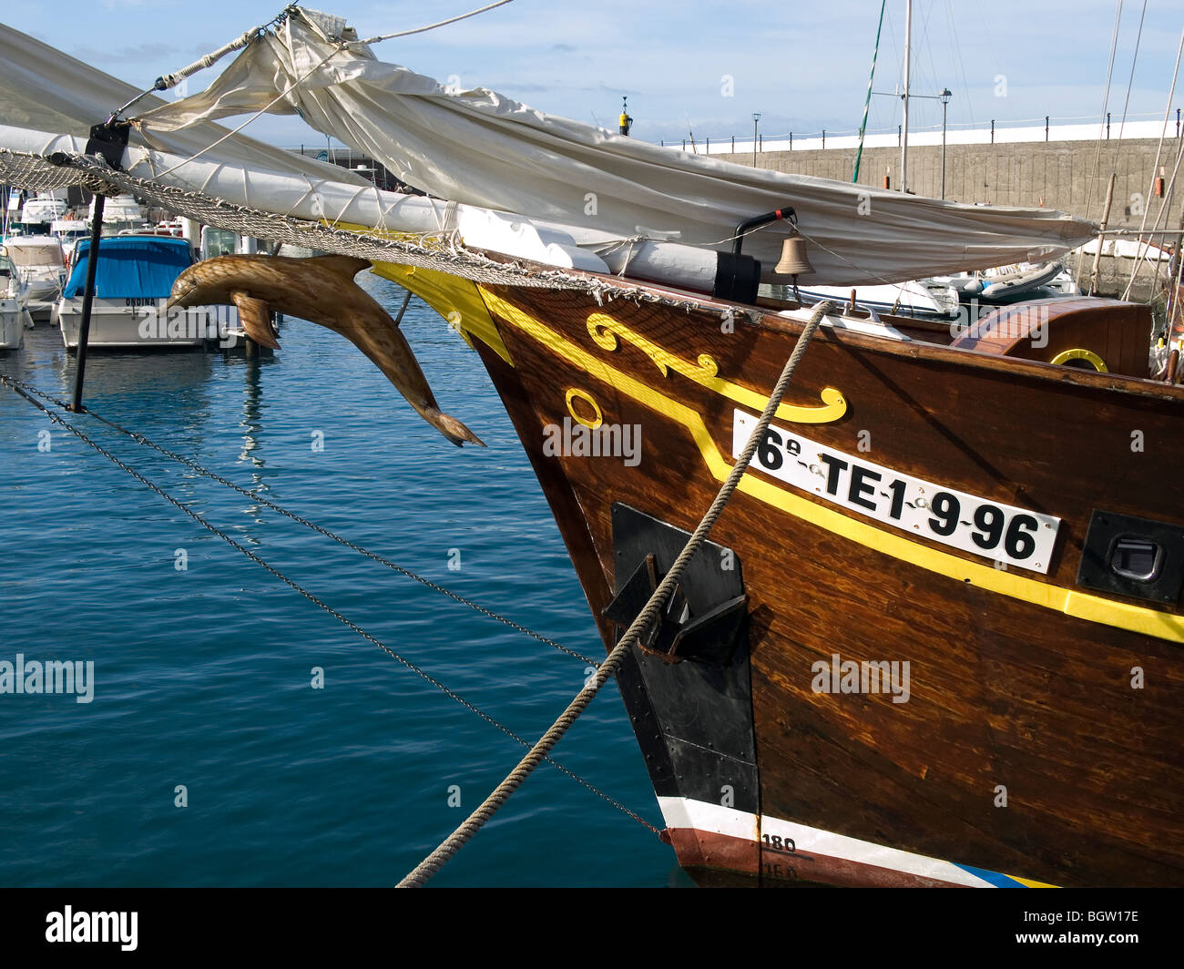 Bow of a wooden boat used to take tourists whale and dolphin watching in the marina at Los Gigantes Tenerife - Stock Image