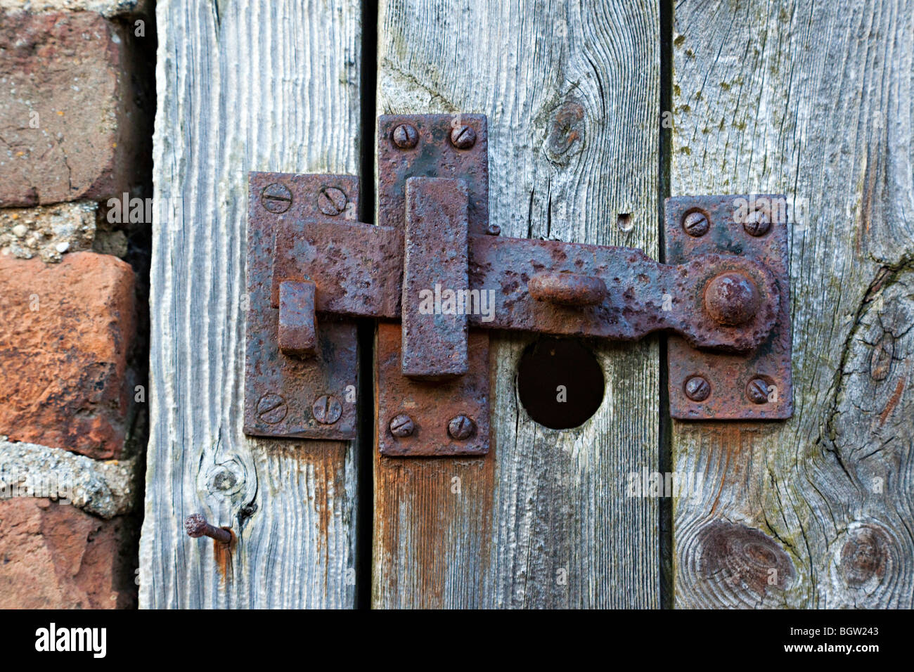 rusty old latch lever lock - Stock Image