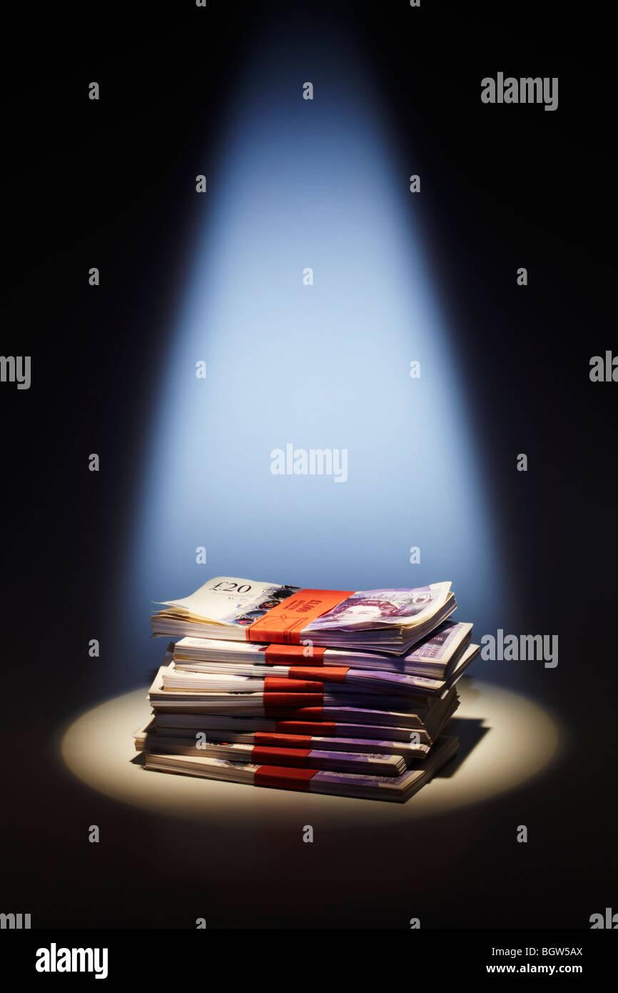 Stack of Twenty Pound Notes under Spotlight - Stock Image