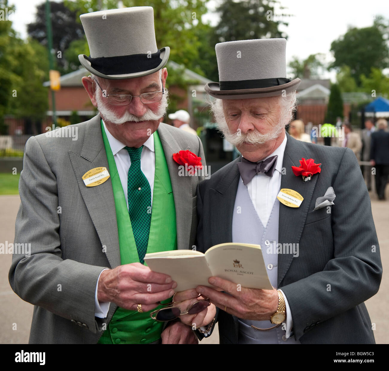 Two gentlemen reading the race program at Royal Ascot - Stock Image