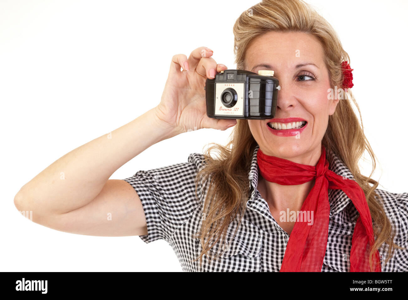 woman dressed in 1950's style holding a Kodak Brownie camera - Stock Image