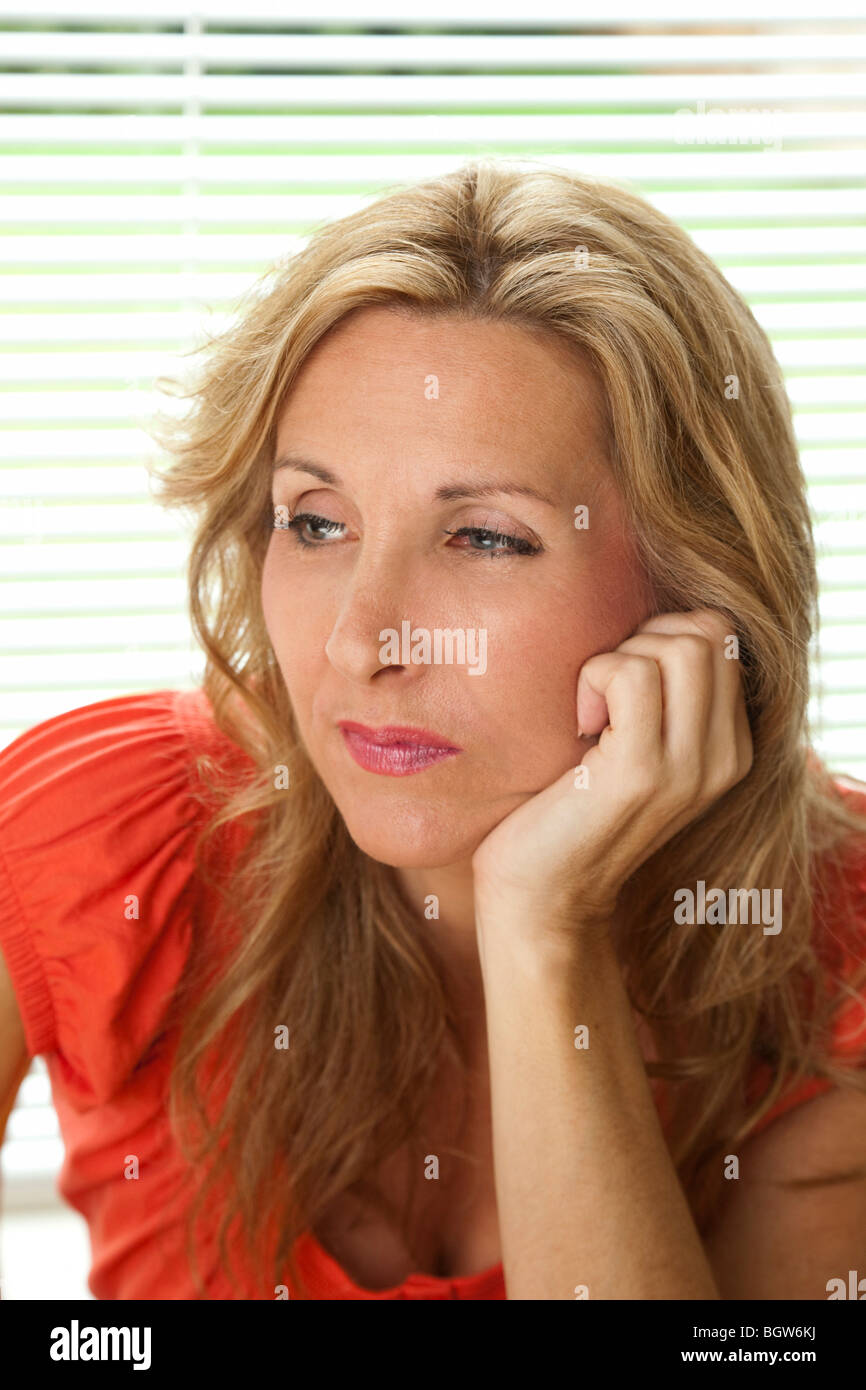 woman in deep thought - Stock Image