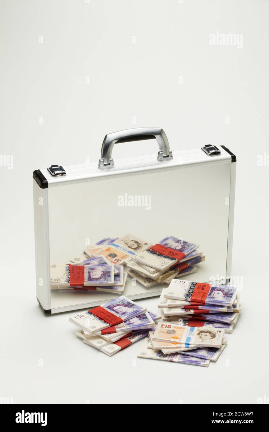 Bundles of Tens &Twenties  Bank notes Reflected in Silver Brief Case - Stock Image