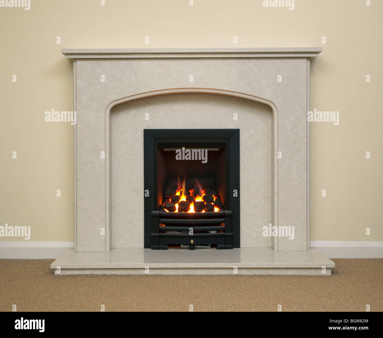 marble fireplace with gas fire flames - Stock Image