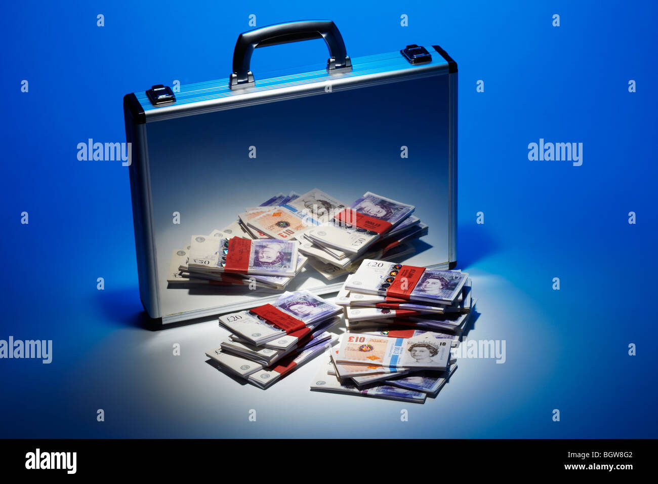 Bank Notes Stacked Reflected in Silver Brief Case - Stock Image